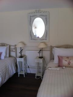 Bedroom with 2 single and 1 Double bed