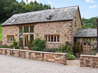 THE LODGE FARM BARN, family friendly, character holiday cottage, with a garden i