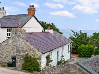 CRAIGLWYD BACH, pet friendly, with open fire in Llandudno, Ref 8492