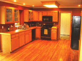 Fully-stocked kitchen with gas stove and quality Calphalon cookware and flatware