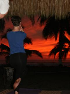 Sunset yoga in the beach Palapa.