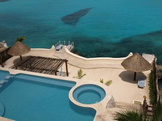 25% off Stunning 2BR Condo in Rare, Private Ocean Setting Cantamar 303 near town, Cozumel