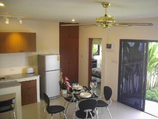 fully equipped kitchen with dining table and living room