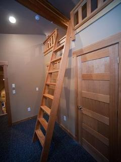 Handmade ladder accessing  master bedroom mini loft