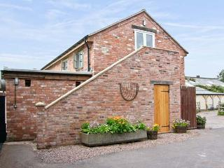 THE BARN, pet friendly, country holiday cottage, with open fire in