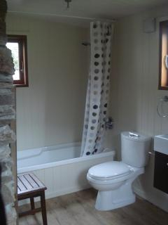 Full bathroom with separate bath and shower.