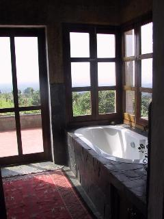 Master bathroom looking out over volcano and valley, spectacular at night