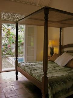 4 Poster King Size Bed with view to Pool