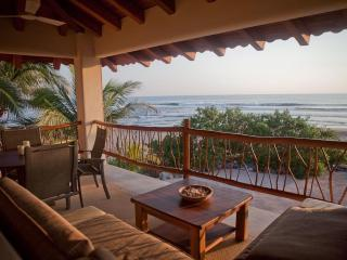 Beachfront Penthouse flat w/panoramic ocean views & the best sandy swim beach!