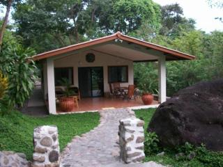Cottage #1 porch with pool ,river and volcan baru view