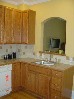 Granite counter tops & tile backsplash - Watch TV from the kitchen