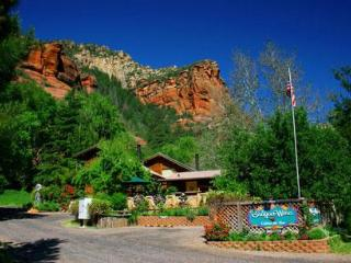 As you drive up Oak Creek Canyon, we are located against the red rocks in a parklike setting.
