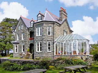 PENSARN HALL, pet friendly, character holiday cottage, with a garden in, Llanbedr