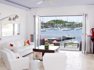Open the entire doors and view the beautiful marina, boats and diving seagulls.