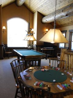 Game loft located in the lodge.  Has pool table, shuffleboard, and poker table as well as TV lounge.