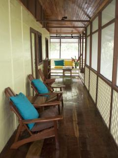 Upstairs porch and hallways outside of bedrooms. Ocean is to the right.