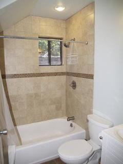 Lower full bathroom adjacent to queen bedroom