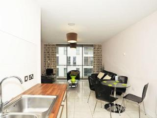 Open Plan Living / Dining Area with Private Balcony