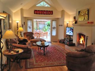 Relax in the great room with raised ceilings and gas/wood burning fireplace.