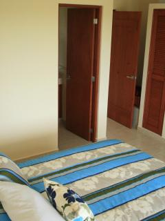 Blue Pool Room - looking across bed to private bathroom, and closet