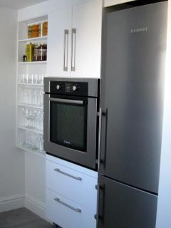 Kitchen with 30' Bosch Oven & Liebherr Refrigerator with Ice Maker