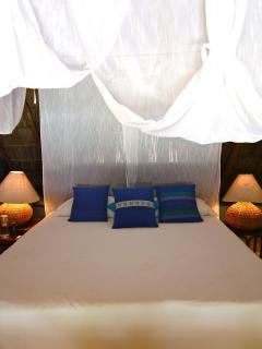 King bed in the Palapa suite that can be split into 2 twins