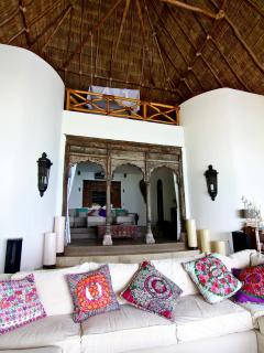 Main Villa living room beneath the beautiful 60 foot palapa ceiling