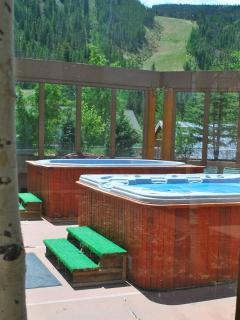 Two relaxing hot tubs overlooking the ski slopes!