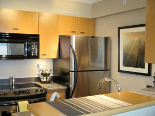 Kitchen area with stainless steel appliances and breakfast bar
