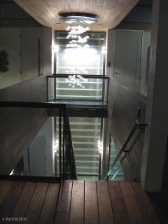 3rd floor Chandiler over glass stairs