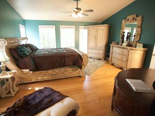 Luscious teals and chocolates invite guests to settle in for deep, extended rest in the Master Suite