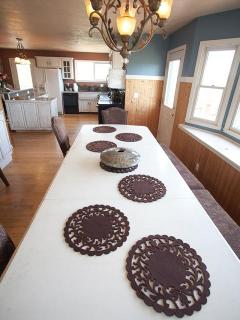 Our long table seats 14 with 6 more in the kitchen...spill onto the deck for a dozen more...