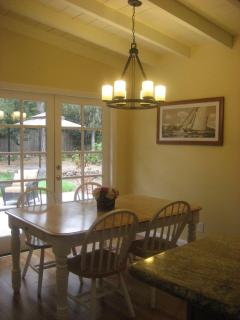 Dinning area open to the kitchen and overlooking lush back yard