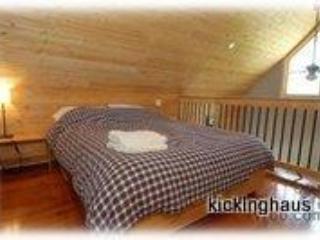 queen size bed in open loft
