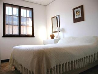 One of the two identical double-bedded rooms in the guest wing