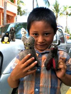 Boy selling handmade stuffed animals