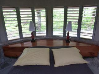 Mango bedhead and red cedar louvers