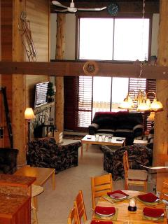 Sixteen foot ceilings and lots of wood features provide a true ski lodge experience