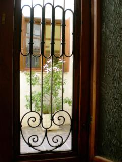 The wrought ironwork on the Ottoman doors lets the air in when you want, but keeps the house secure