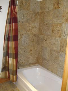 Bathroom has large soaking tub w/shower