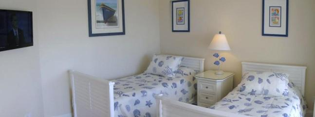 bedroom 4  twin beds  en suite with private deck with sea view and HD TV
