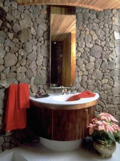 A natural skylight illuminates the sink in the main bathroom.