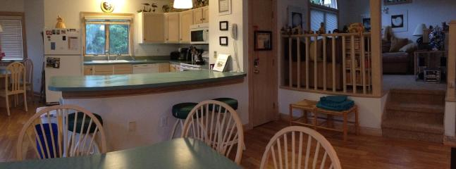 Kitchen from living area showing loft to right.  Perfect gathering area.