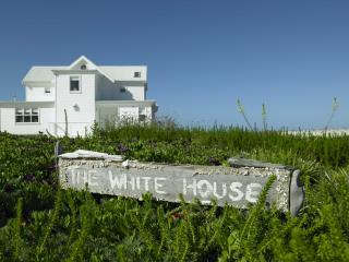 Set back from road with views across sea to Table Mountain and Dassen Is. Short boardwalk to beach.