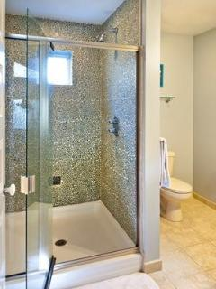 Iridescent glass pebble custom shower