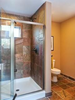 Custom slate/glass bathroom