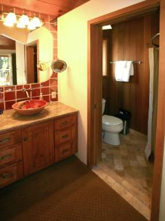 Master Bath with Clear Cedar Lined Shower, Natural Stone/Granite