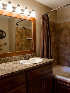 Bathrooms have granite counter tops