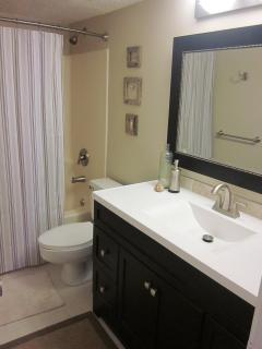 Updated second bathroom with new vanity and modern fixtures.