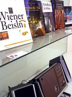 Stereo system and reading material about vienna